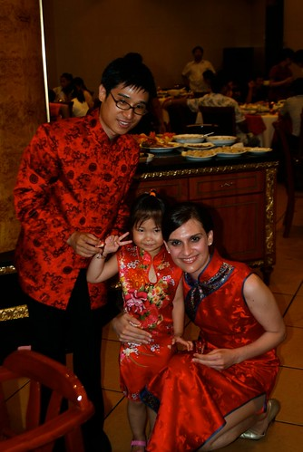 John and I pose with a girl on our wedding day in China