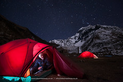 View from the tent (Alex Treadway) Tags: camping nepal light red camp terrain mountain snow man mountains male nature smile sport blackbackground night trekking trek stars outdoors happy photography climb asia looking hiking sleep walk awesome extreme scenic peak tent glacier snowcapped adventure explore journey midnight summit environment glowing inside nightsky nepalese himalaya majestic eastern challenge naturalworld himalayas isolated oneperson constellation millions highaltitude nepali colorimage manaslu 3040years traveldestination colourimage plainbackground warmclothing 2030years 8000mpeak