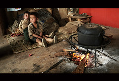 YI (BoazImages) Tags: poverty life china family boy woman home kitchen fire sad documentary indoors yunnan minority yi hilltribe supershot boazimages