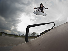 Joe Morris - Kickflip Over Rail (Ryan Bradley.) Tags: clouds dark photography skateboarding bright skatepark photograph skate skateboard gnarly handrail dope sick kenilworth kickflip joemorris ryanbradley nikond40 yongnuoyn460 opteka65mmfisheye