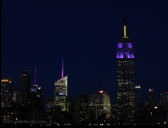 Empire State Building in Purple and Yellow with the Bank of America Tower, 4 Times Square spires (NYCisMyMuse) Tags: nyc newyorkcity newyork architecture evening landmarks empirestatebuilding 30rock bankofamericatower 4timessquare onebryantpark purplepurpleyellow nycismymuse