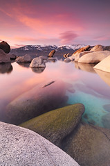 Breathless - Sand Harbor State Park, Lake Tahoe (Joshua Cripps) Tags: statepark pink sunset red sky lake snow mountains reflection texture water beautiful rock clouds still aqua purple turquoise teal nevada smooth tahoe boulders alpine granite submerged sierranevada creamy sandharbor joshuacripps