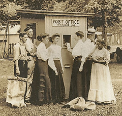 Smallest Post Office in U.S., Wawasee Lake, Indiana section (Hoosier Recollections) Tags: people woman usa signs man men history sepia fence buildings walking advertising clothing women workmen mail postoffice indiana porch pedestrians lakewawasee realphoto kosciuskocounty hoosierrecollections