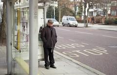 He waits (the underlord) Tags: street man cold bus film 35mm waiting alone candid rangefinder 200asa busstop fujifilm shelter southport gentleman merseyside jupiter8 fujisuperia200 lordstreet russianlens r4a jupiter8502 voigtlanderbessar4a believeinfilm
