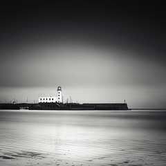 A lighthouse darkly (c e d e r) Tags: ocean uk longexposure sea england bw seascape pier scarborough nd110 daytimeexposure