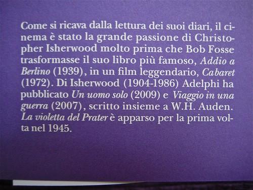 """Christopher Isherwood, La violetta del Prater, Adelphi 2011; [responsabilità grafica non indicata], alla cop.:""""Fotografia di scena dal film """"The Barker"""" (1928), risvolto di cop. (part.), 1"""