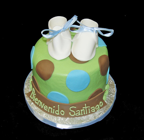 green blue and brown polka dot topper baby shower cake with baby shoes
