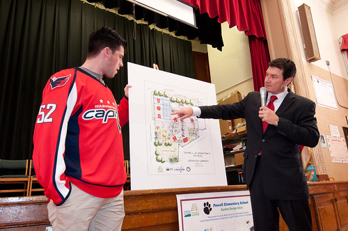 Washington Capitols Defenseman, Number: 52 Mike Green (left) and Comcast SportsNet Analyst Alan May of the The People's Garden team for W. B. Powell Elementary School, (consisting of the Washington Capitols, U.S. Department of Agriculture and D.C. Public Schools in Washington, D.C.) revealed to 289 parents and students, the School Garden Design Concept on Thursday, March 10, 2011.  The design draft was created by Forest Service landscape architect Matt Arnn, with the support of Natural Resources Conservation Service landscape architect Bob Sneickus, Outreach and Education Coordinator Annie Ceccarini and Project Manager Leslie Burks who worked with the Principal Janeece Docal and the school during an earlier visit to develop illustrated ideas from parents and students. USDA photo by Lance Cheung.