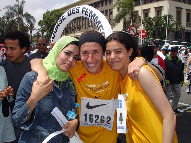Ziba (center) after finishing the Casablanca Course Feminine – a 10K for women where 25,000 women and girls take over the streets of Casblanca. The race was organized by Nawal el Mutawakel, first Arab woman to win Gold at the Olympics.