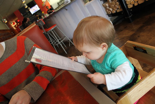 Examining the menu at Pizzeria Lola