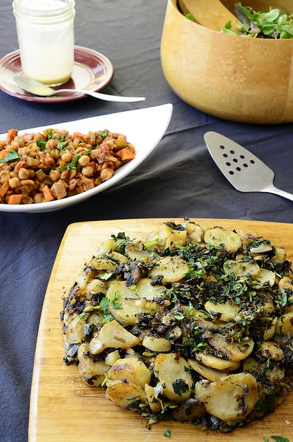 potato, greens, and mushroom cake w/ braised chickpeas