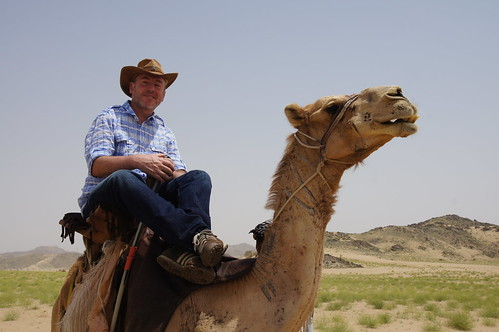 Camel riding with a cowboy hat in the Arabian desert by CharlesFred