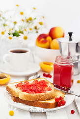 Fresh toasts with jelly, cup of coffee and fruits for breakfast (Katty-S) Tags: marmalade jam jelly toast bread breakfast red curant berry fruit summer coffee lunch light cup snack traditional brunch crunch crust crusty piece homemade morning jar toasted food drink butter apricot peach