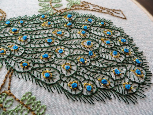 Peacock feather embroidery close up