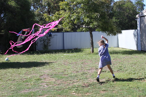Esther flying a kite