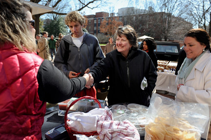 Agriculture Deputy Secretary Dr. Kathleen Merrigan meets with local producers at the North Carolina University's student run Farmer's Market in Raleigh, NC, on Feb. 9, 2011.