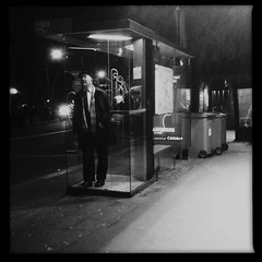 Night On Earth (benedicte guillon) Tags: street blackandwhite bw man paris night square loneliness phone noiretblanc telephone streetphotography nb squareformat cinematic iphone iphoneography hipstamatic mobformat11streetnoir