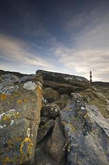 RockRectangle (Leathanach) Tags: blue red sky lighthouse white clouds nikon rocks stripes shoreline lichen tarbatness d700 landscapesshotinportraitformat