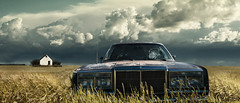 On Coyote Road (bealluc) Tags: abandoned grass wheat saskatchewan plains prairies stormclouds darksky abandonedcar thegreatdepression smashedwindshield