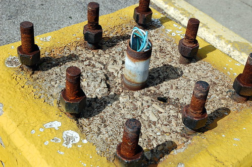 light urban yellow electric concrete wire rust decay parking lot bolt fixture