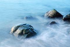 Sunrise Rock (olivr) Tags: reflection film water rock fog nikon fuji boulder velvia motionblur fm3a firstlight transient movingwater earlylight reflectedlight wetrock rvp100