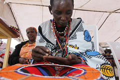 Maasai women make, sell and display their bead work (World Bank Photo Collection) Tags: africa woman work necklace hands women commerce employment kenya jobs handmade working craft jewelry business bead vendor sell selling masai maasai worldbank beadwork