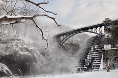 Reaching Through the Mist - in Explore, Front Page (SunnyDazzled) Tags: bridge winter mist snow newyork ice clouds sunrise waterfall dam branches stonework foggy gorge croton spillway