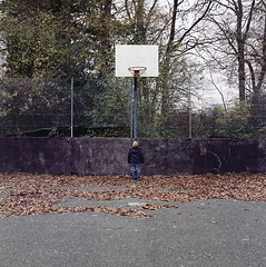 (Brownthing) Tags: winter abandoned leaves tarmac basketball hoop court concrete woods child decay