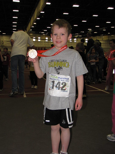 Benjamin and his TC Kids Marathon medal