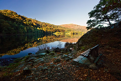take a seat (Dennis_F) Tags: uk autumn england lake reflection fall nature zeiss bench landscape unitedkingdom district grasmere seat sony united herbst wide lakedistrict bank kingdom take fullframe dslr landschaft lakeland ultra spiegelung ssm thelakes 1635 uwa thelakedistrict weitwinkel ultrawideangle uww a850 163528 sonyalpha sonydslr vollformat zeiss1635 sal1635z cz1635 sony1635 dslra850 sonya850 sonyalpha850 alpha850 sonycz1635