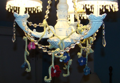Chandelier with garland of crochet flowers