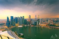 Singapore Skyline from the Skywalk (sachman75) Tags: sunset storm tourism water clouds river asia southeastasia dusk views touristspot mbs observationdeck vantagepoint skywalk integratedresort canon1740mmf4 leefilters marinabaysands 5dmark2 canon5dmarkii gradnd3stop