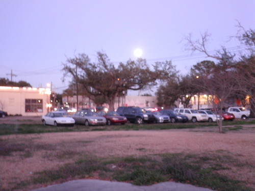 Full Moon over a perfect line of illegally parked cars