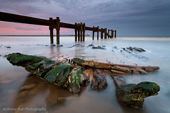 Blyth Wreck (Azzmataz) Tags: sunset lighthouse beach pier pipe hull wreck blyth