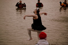 The Black Swan dances in Eagle Creek Park. (kennethkonica) Tags: costumes red ballet usa black men water women faces dancing legs indianapolis indiana tights ems firefighters blackswan specialolympics eaglecreekpark bodylangauge indianapolisfiredepartment thepolarplunge radionow1009 indyflickr22611