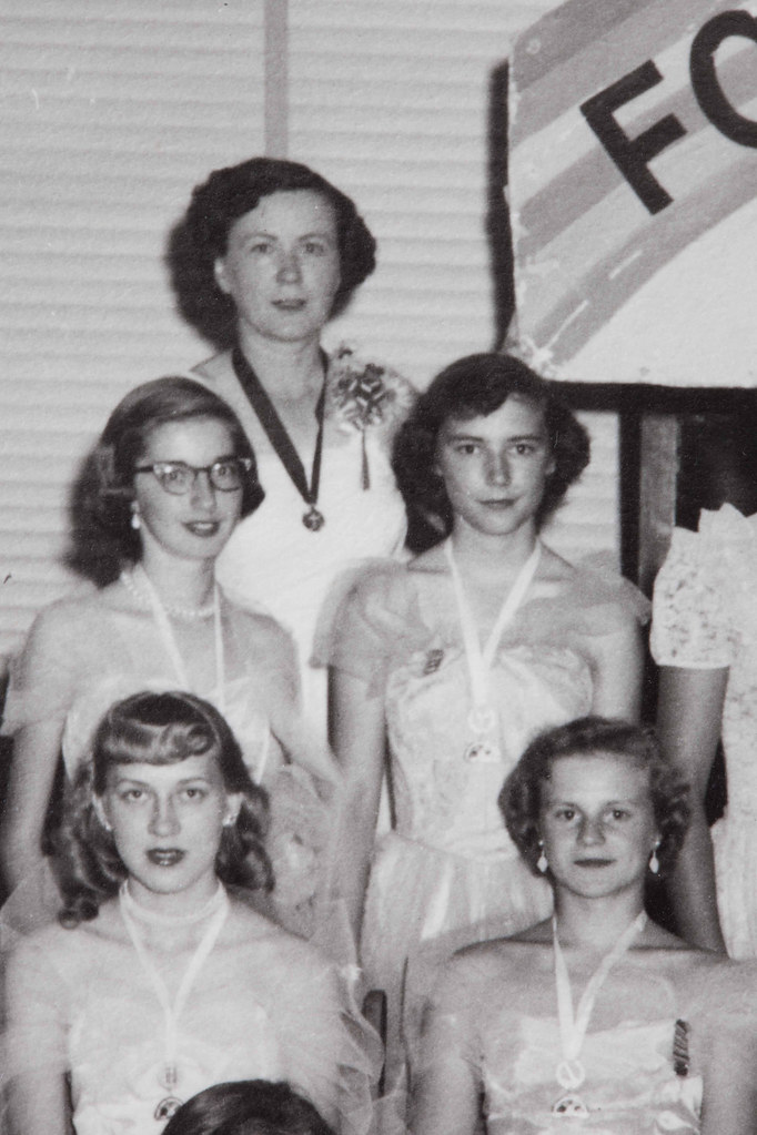 Detail of a 1950s photo of the International Order of the Rainbow for Girls in Rugby, North Dakota - Catherine Hornstein (standing, back row) was the Mother Advisor - Photo by Stands Studio of Rugby,