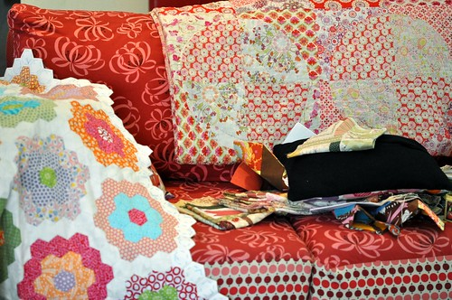 quilts and stuff on couch