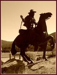 Going west, Santa Fe (LarrynJill) Tags: sculpture mountains newmexico santafe art sepia picnik horseman vacation2008