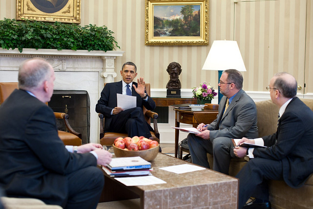 President Barack Obama receives a briefing on the earthquake in Japan and the tsunami warnings across the Pacific in the Oval Office, March 11, 2011.