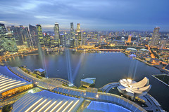 When the sun goes down... Marina Bay starts to dazzle... (williamcho) Tags: shopping singapore malls casino business hotels bluehour attraction d300 marinabay businessdistrict foodbeverage marinabaysands serviceapartments williamcho artsciencemuseum flickrtravelaward