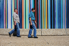 People and stripes I - La Defence - Paris - France (tom.wright) Tags: city blue red people orange paris france colour green yellow horizontal walking duct person grey europe walk district pipe stripe line business step raymond colourful defence striped ventilation ladefence tomwright businessdistrict canonefs1785mmf456isusm morretti copyright2010 raymondmorretti