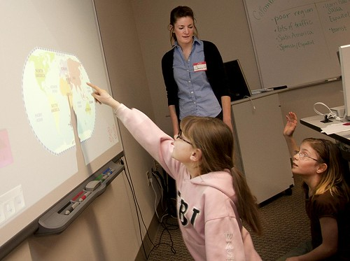 students working with a smart board