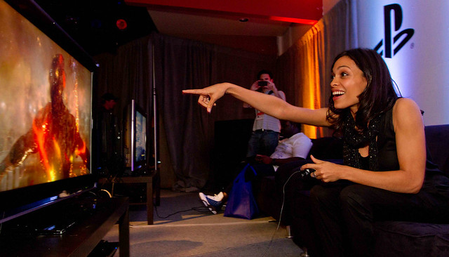 Rosario Dawson gaming - Sara Kerver for WireImage