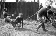Cleaning Up (theirhistory) Tags: bramcote bramcoteschool bramcotehall boy child school wall jumper trousers wellies stick grounds earth uk britain unitedkingdom england primary junior gb class form pupils students education