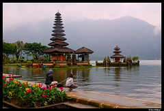 Fishing at Pura Ulun Danu (Dan Wiklund) Tags: bali lake reflection water clouds indonesia temple fishing fishermen cloudy d200 hindu indonesian 2010 puraulundanu candikuning