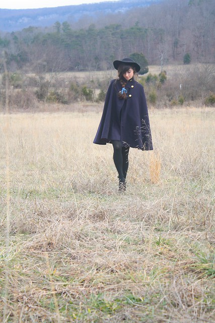 swingy capes, wide brimmed hats