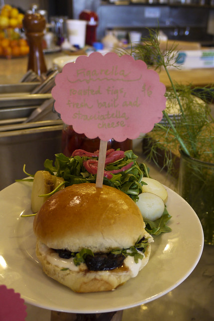 Roasted fig, fresh basil and stracciatella cheese sandwich with salad of arugula, red onion and fingerling potatoes