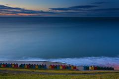 Colourful beach houses, Whitby (paul indigo) Tags: sea colour beach coast vibrant whitby cabins
