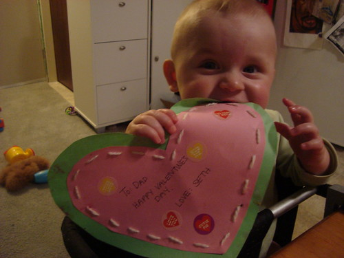 seth putting the finishing touches on his dad's valentine.
