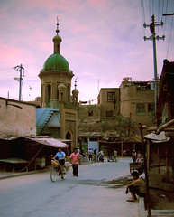 kashgar - the other side of world (Xuan Che) Tags: 2005 china street city travel pink light sunset summer sky west tower history architecture clouds august mosque belltower oasis xinjiang silkroad kashgar uyghur centralasia canonixus400 islamic eurasia